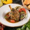 Фото к позиции меню Голень ягненка с овощами гриль