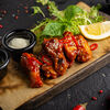 Фото к позиции меню Крылья куриные с соусом