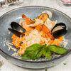 Фото к позиции меню Ризотто с морепродуктами в томатно-сливочном соусе