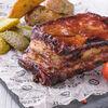 Фото к позиции меню Свиные ребрышки в соусе барбекю