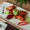 Фото к позиции меню Куриные крылья по-шанхайски
