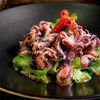 Фото к позиции меню Мини-осьминоги с кинзой и кунжутным соусом