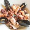 Фото к позиции меню Бурый рис с осьминогом, кальмаром и креветками гриль