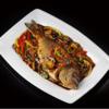 Фото к позиции меню Морская рыба на воке в стиле