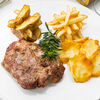 Фото к позиции меню Стейк из свинины с картофелем айдахо