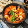 Фото к позиции меню Морепродукты, томленные в неаполитанском соусе