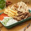 Фото к позиции меню Гирос с курицей на тарелке