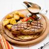 Фото к позиции меню Стейк из свинины с перечным соусом и картофелем по-деревенски