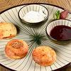 Фото к позиции меню Сырники с малиновым соусом