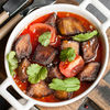 Фото к позиции меню Баклажаны с томатами и чесноком