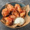 Фото к позиции меню Куриные крылья с остро-сладким соусом