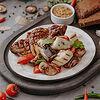 Фото к позиции меню Стейк из свинины BBQ c овощами гриль