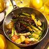Фото к позиции меню Теплый салат с щупальцами осьминога