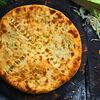 Фото к позиции меню Пирог с капустой и сыром стандартный