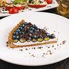 Фото к позиции меню Голубичный тарт (порция)