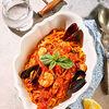 Фото к позиции меню Тальятелле с морепродуктами в соусе из томатов