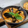 Фото к позиции меню Соте из морепродуктов в томатном соусе