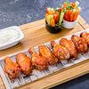 Фото к позиции меню Куриные крылья в соусе BBQ