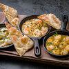 Фото к позиции меню Ассорти морепродуктов в чесночном соусе